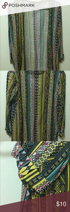 Multicolored Cardigan I got this when i went to Turkey for the summer. I never wore i liked it then but when i came back just never came across to wear it. It is colorful and thin material. It has cuffed arms and it mid arm length. Size S Jackets & Coats Blazers