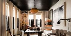 Milan Apartment, Black Painted Walls, Georgian Homes, Framing Photography, Los Angeles Homes, Elle Decor, House Tours, Bungalow, Family Room