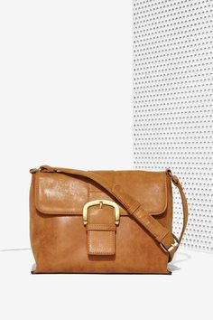 Pair the Carried Away Crossbody Bag with a slouchy knit, skinnies, and flats.