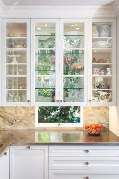 traditional kitchen by Rochelle Silberman cabinet over the window. that is actually really beautiful