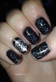 NYE nails - Zoya Storm stamped using @Messy Mansion MM02 #nye #nailart #nyenails #holographicpolish