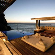 Infinity pool + ocean + cozy potential reading nook? Yes please.