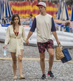 Just the two of us: Ansel Elgort and his pretty girlfriend Violetta Komyshan looked the picture of happiness as they enjoyed a romantic beach stroll in the Italian coastal village of Positano on Thursday