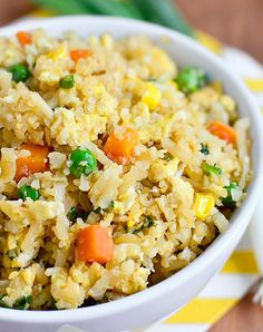 Cauliflower Fried Rice (Video) - Iowa Girl Eats Cauliflower Fried Rice will trick your tastebuds in the best way possible. This 20 minute gluten-free, low-carb recipe will be a hit at your house! Rice Recipes, Low Carb Recipes, Cooking Recipes, Healthy Recipes, Vegetable Recipes, Cooking Rice, Vegetarian Cooking, Healthy Options, Healthy Cooking