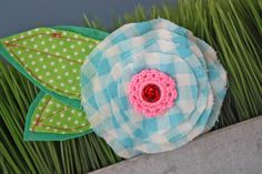 fabric flower. no instructions, figure it out. add crochet in center?