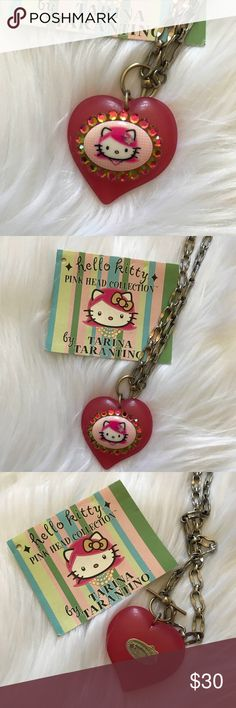 Tarina Tarantino Hello Kitty Pink Head Necklace Tarina Tarantino Hello Kitty Pink Head Collection.  Puffy Heart Toggle Necklace with Hello Kitty and Crystals.  Brand new condition for necklace, never worn.  Chain link Silver Tone Necklace.  Rare!  No longer sold!  Comes with card.  Officially licensed by Sanrio.  Authentic item, purchased from Bloomingdales when they were first released.  Signed plate on back. Tarina Tarantino Jewelry Necklaces