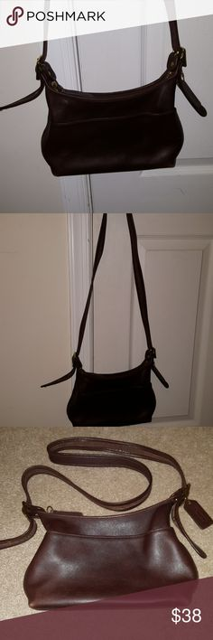 Brown leather vintage Coach crossbody bag Vintage brown leather Coach crossbody bag. Great condition. Some scuffs on bottom from use. 11x6x3.   Check out the fabulous finds in my closet. Bundle for additional discount. 🤗🦋🌹🎀⚓😊 Coach Bags Crossbody Bags