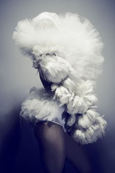 Soft Sculptural Fashion with layers of white feathers & tulle; artistic…