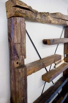 Rustic reclaimed & staggered shelving unit I can just imagine this with classics pouring off of each shelf.