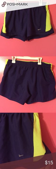 Nike running shorts purple and neon green size M Nike dark purple and neon green running shorts size medium. In perfect condition! Built in underwear and mini inside pocket. Adjustable strings on the inside for best fit! Nike Shorts