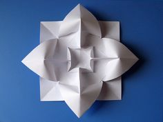 Fiore bombato - Curved flower.  Origami from one uncut square of copy paper, 21 x 21 cm.  Designed and folded by Francesco Guarnieri,  March 2009