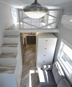 The Olivia provides an abundant amount of storage space, including a custom hide-away storage staircase that takes up less floorspace than a typical staircase when not in use.