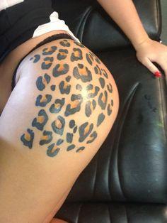Leopard print tattoo on the buttock