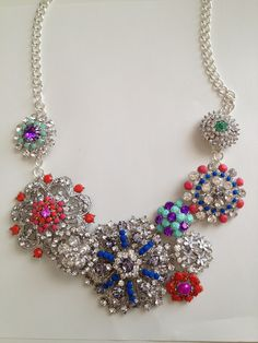 From The Berrylicious Life: DIY statement necklace. Paint brooches with nailpolish or color with sharpies and attach to a chain to create this j.crew copycat