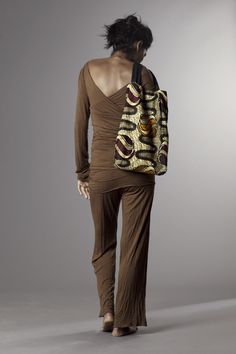 sugar brown jersey sweater and trousers wax and leather bag