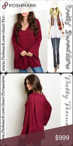 """NWT Long Bell Sleeve Wine Top NWT Long Bell Sleeve Wine Top  Available in sizes S, M, L Measurements taken from a small  Length: 31"""" Bust: 38"""" Waist: 42""""  Rayon/Spandex  Made in the USA  Features  • long bell sleeves  • stunning deep wine color • rounded plunging v-neckline  • úber soft material (seriously, you'll want to live in this😍) • relaxed fit  Bundle discounts available  No pp or trades  Item # 1/1-7200390WPB Pretty Persuasions Tops Tees - Long Sleeve"""