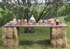 Get creative with hay stacks! Use them with an old door to create a fantastic buffet table! You can also use them as benches with a quilt/blanket on top to make the seat more comfy