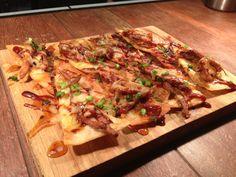 Yummmm! Bar 145 Nachos: pulled pork, homemade tortilla chips, BBQ sauce, green onions, sweet chili sauce! #Bar145 #Gastropub