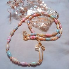 Christian/ Easter necklace made from Beach themed scrap book paper. Every other bead is glittered for added interest.