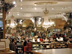 Fortnum & Mason, like a glam Willy Wonka. Tea, jam, biscuits, chocolates, coffee, etc. Fabulous souvenirs. (Try a tin of rose or ginger chilli bisquits. The tins are stunning) Go for afternoon tea. One of the best places on earth.