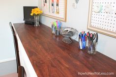 Erin used laminate flooring for her craft desk table top--genius! via How to Nest for Less