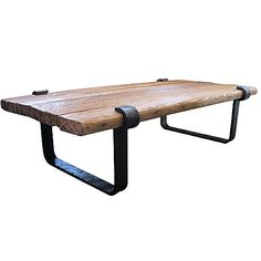 Rustic barnwood table top pairs nicely with the hand wrought iron clasp base. Edges are rounded to soften the lines. This is an original R.T. Facts design.There's nothing like merging the natural quality of wood with the industrial strength of iron — and this coffee table definitely proves that. Place this piece front and center as the showstopper in your living room.