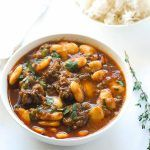 Jamaican Oxtail Stew. I'm making this in my slow cooker right now!