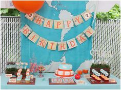 Cute UP-Inspired Birthday Party in mod aqua + orange with pilot/airplane motif! Map backdrop, cute map banners too!