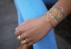 Knotted macrame bracelets - these would be really cute with washers and other goodies from the junk drawer, instead of the (admittedly very pretty) goldtone findings in the picture.