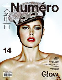 Doutzen Kroes shines in a fall-winter Louis Vuitton hat for the December cover of Numéro China. Captured by Tiziano Magni, Doutzen is an alluring vision with red lips and rouged cheeks.