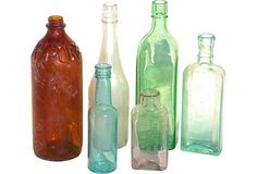 "Six antique and vintage glass bottles in a wonderful variation of shades. The bottles range from 11""H for the tallest to 6""H for the smallest.  No MM - $65 - SOLD on OneKingsLane.com"