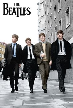 The Beatles. Paul looks like a public school boy in his cardigan sweater. Very nice.