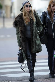 Cara Delevingne was seen arriving at Gatwick Airport wearing a fetching furry parka jacket