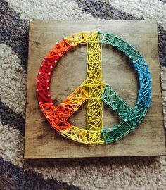 https://www.etsy.com/listing/226073451/made-to-order-peace-sign-string-art-sign
