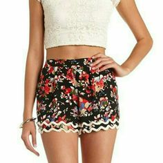 """Floral Fringe Shorts Shorts from ASOS feature bright colors in a floral print, small ivory fringe detail, and elastic waist band. True size XL. Inseam is 2"""". Tags accidentally ripped off. ASOS Shorts"""