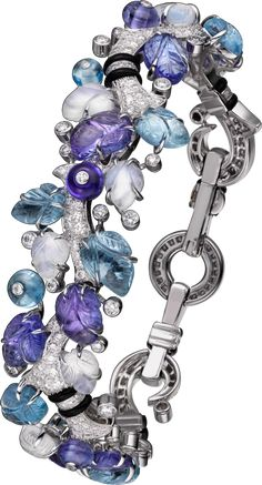 CARTIER - Bracelet with engraved stones, 18K white gold, set with aquamarines, tanzanites, moonstones, onyx and 298 brilliant-cut diamonds totaling 2.90 carats. (P.R.P. $172,000)