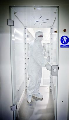 A gowned technician passes through an air shower to blast off dust and dirt particles before entering the strictly controlled clean room attached to ESTEC's Life, Physical Sciences and Life Support Laboratory.This 35 sq. m 'ISO Class 1' clean room provides an ultra-clean environment, suit…