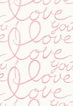 """This bold statement fabric features the words """"I Love You"""" embroidered in freehand lettering on a white cotton ground."""