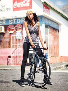 Gina from Namibia. Women fashion Woman standing at her bike. www.patriklinden.se