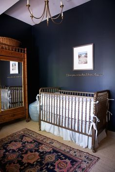 Dark blue walls with gold accent and a ink and blue Oriental rug.. This is a classic, somewhat Edwardian style.  | 7 Creative Nursery Trends