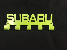 SUBARU Key / Coat / Towel Rack CNC Plasma cut and powder coated with a choice of colours. Mounts easily with two holes and have 5 hooks so you never loose your keys again. Dimensions are approx 207mm wide by 73mm tall. Choice of Colours. Professionally finished in high quality Powder