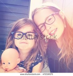 Two beautiful girls together wearing glasses - Instagram effect