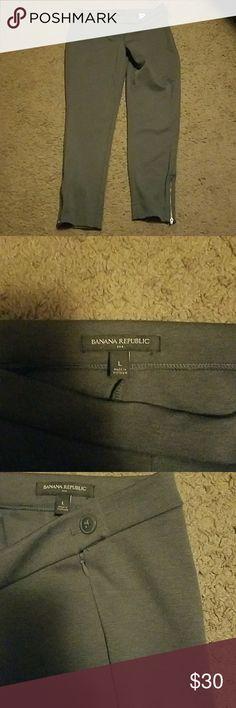 Banana Republic pants. Grey. Large. NWOT. Banana Republic pants. Grey. Large. NWOT. Never worn. Just too big. Zippers on both bottom legs. Side button and zipper at waist Banana Republic Pants Trousers