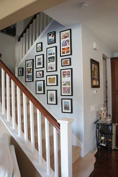 This is a fun gallery wall!  The framed art being of very similar size, the repetition and intensity of colors, and the same frame color, @Barbara Wirth Art reveals is the secret to making this very  interesting and, though many pieces, not over-powering.