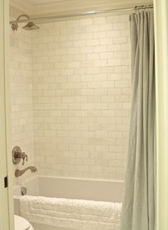 Tile:  Dolomite White Tumbled Marble; softer look than traditional shiny subway tile