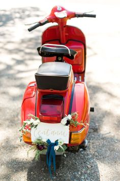 Vintage vespa for two - we love the delicate wedding decorations.