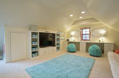A kid's place to hang out.  Entertainment center with desk for ding homework. by http://www.ultimatestoragesystems.com/