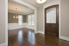 "Oak floors. Stain is Minwax Dark Walnut. Trim is BM Dove White. Benjamin Moore 984 ""Stone Hearth""- Foyer Benjamin Moore 1475 ""Graystone""- Dining Room"