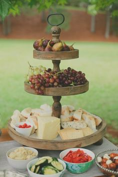 Cheese fruit platter Love the wooden food display Cupcake stand Cheese Fruit Platters, Cheese Table, Cheese Trays, Cheese Bar, Cheese Display, Wooden Food, Wedding Reception Food, Grazing Tables, Food Stations