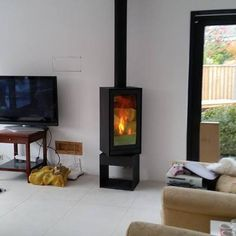 Wood Stove Fireplace, Home And Living, Stove Decor, Home Living Room, Home, Modern Stoves, Wood Burning Fireplace Inserts, Deck Fireplace, Cozy House